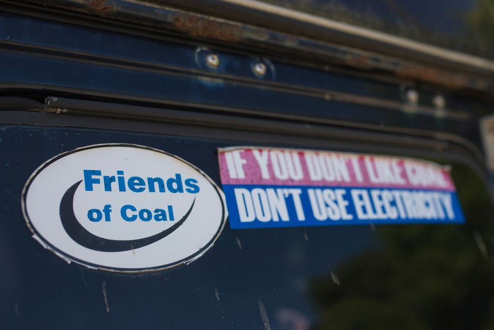 Bumper stickers on a car window in neary Whitesburg, Kentucky, illustrate a resident's support for the struggling coal indust