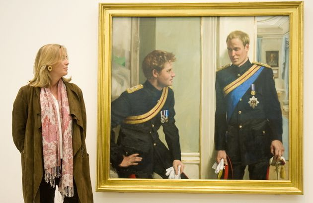 Nicky Philipps stands with her work, 'Prince William and Prince Harry: a new portrait by Nicky Philipps'...