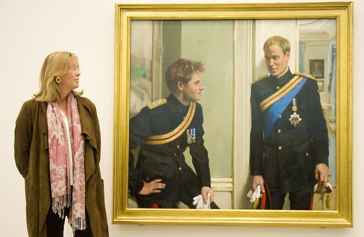 Nicky Philipps stands with her work, 'Prince William and Prince Harry: a new portrait by Nicky Philipps' at the National Portrait Gallery on Jan. 6, 2010.