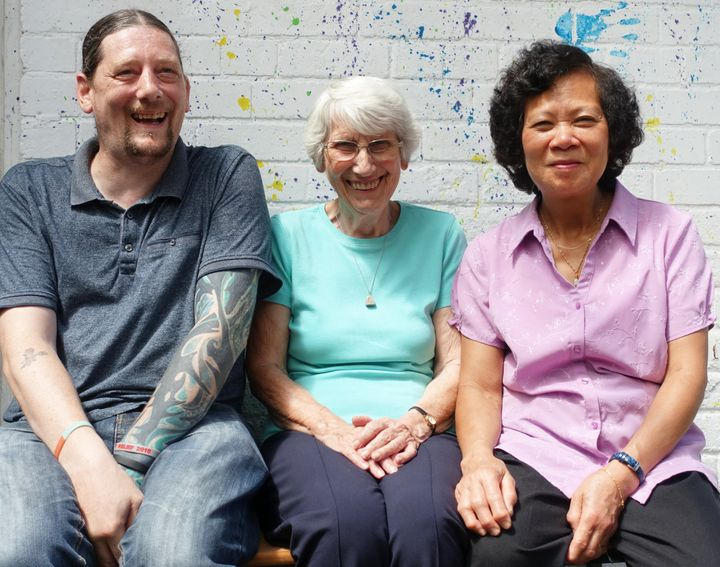 Enid Howles (centre) with two of the people she has supported: RossPurchs (left) and Anh Quach (right).