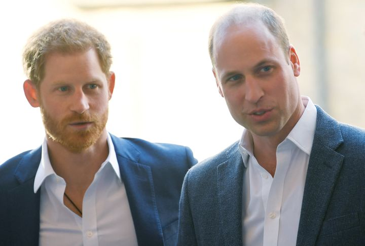 Prince Harry and Prince William attend the opening of the Greenhouse Sports Centre in London on April 26.