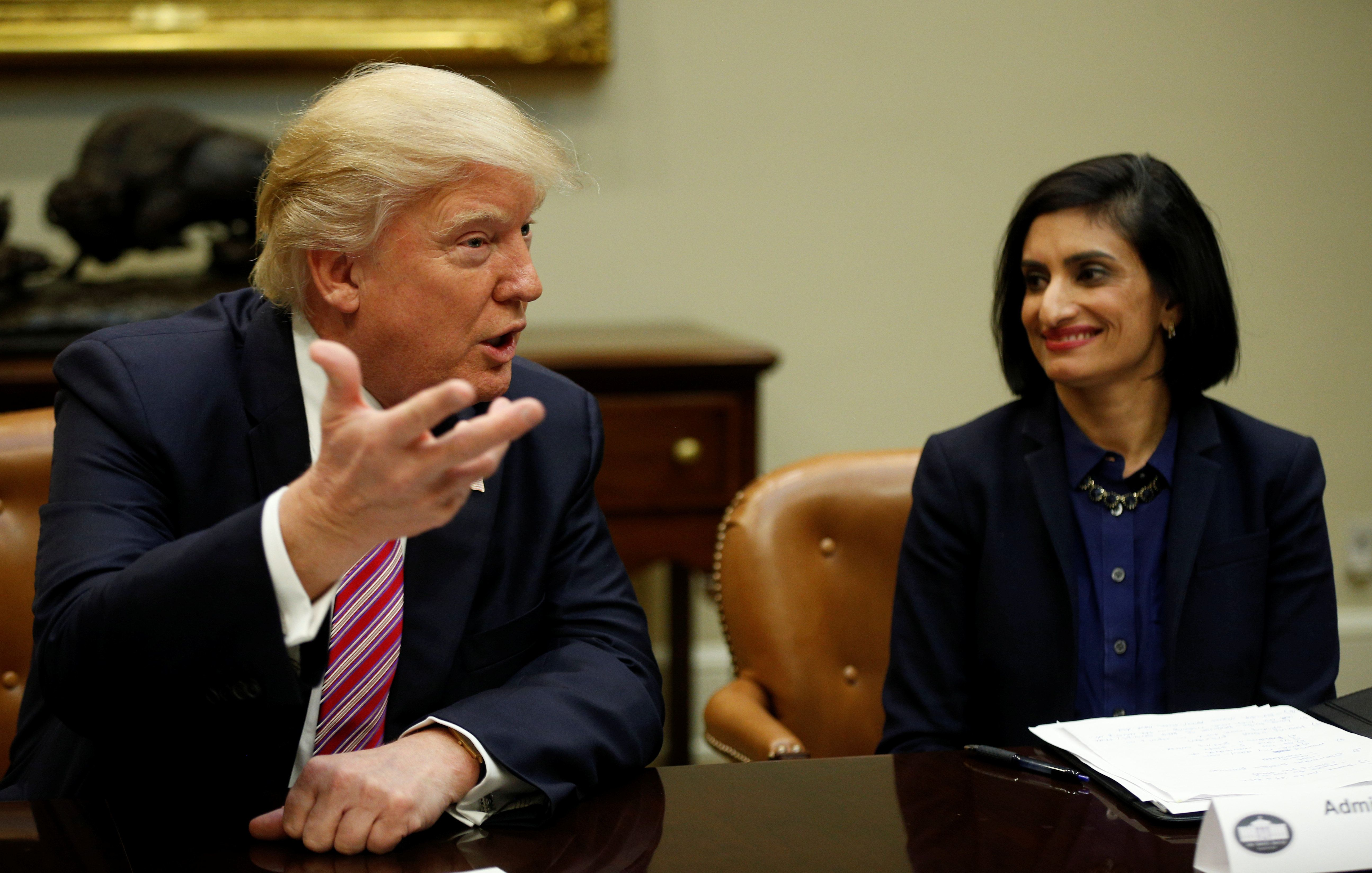 U.S. President Donald Trump attends the Women in Healthcare panel hosted by Seema Verma (R), Administrator of the Centers for Medicare and Medicaid Services, at the White House in Washington, U.S., March 22, 2017.   REUTERS/Kevin Lamarque