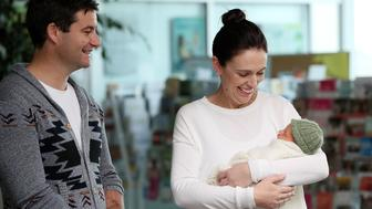 AUCKLAND, NEW ZEALAND - JUNE 24:  New Zealand Prime Minister Jacinda Ardern and partner Clarke Gayford pose for a photo with their new baby girl Neve Te Aroha Ardern Gayford on June 24, 2018 in Auckland, New Zealand. Prime Minister Ardern is the second world leader to give birth in office, and the first elected leader to take maternity leave. Arden will take six weeks of leave with Deputy Prime Minister Winston Peters assuming the role of Acting Prime Minister  (Photo by Fiona Goodall/Getty Images)
