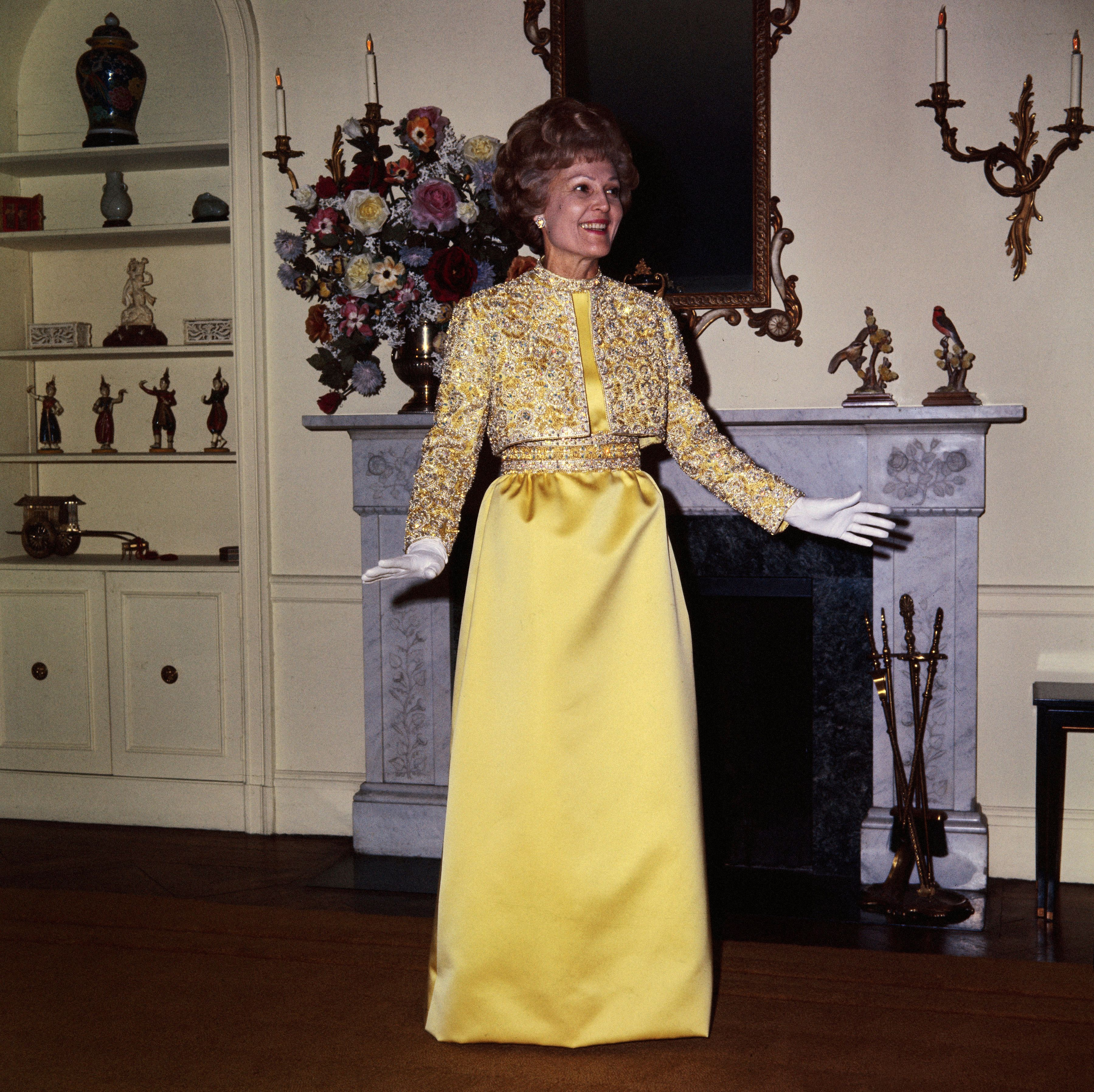 """Here, Nixon is dressed in her first inauguration gown, a yellow silk-satin number with a matching beaded jacket by <a href=""""h"""