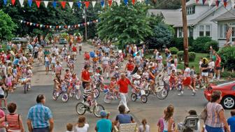 'Audubon, NJ, USA - July 4, 1989: Kids, decorated bicycles, in 4th of July town parade.'