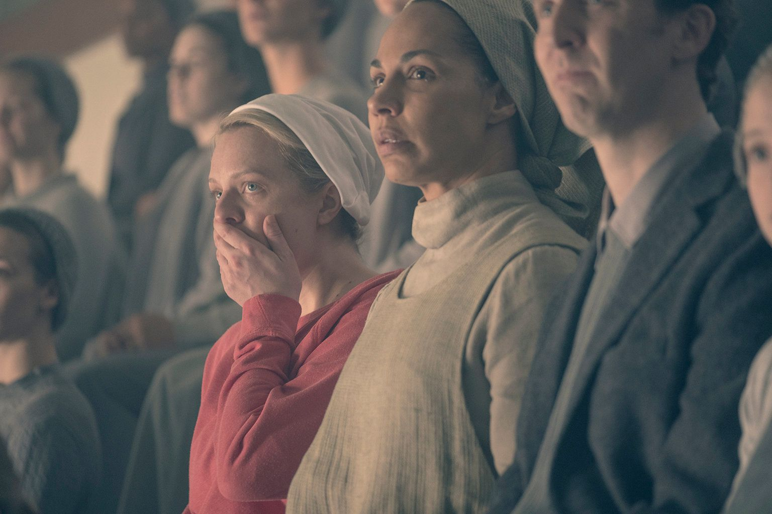 "THE HANDMAID'S TALE -- ""Postpartum"" -- Episode 212 -- Offred is sent to a familiar place. Nick is rocked by Gilead's brutal response to a crime. Emily is assigned to a mysterious new house. Offred (Elisabeth Moss) and Rita (Amanda Brugel), shown. (Photo by: George Kraychyk/Hulu)"