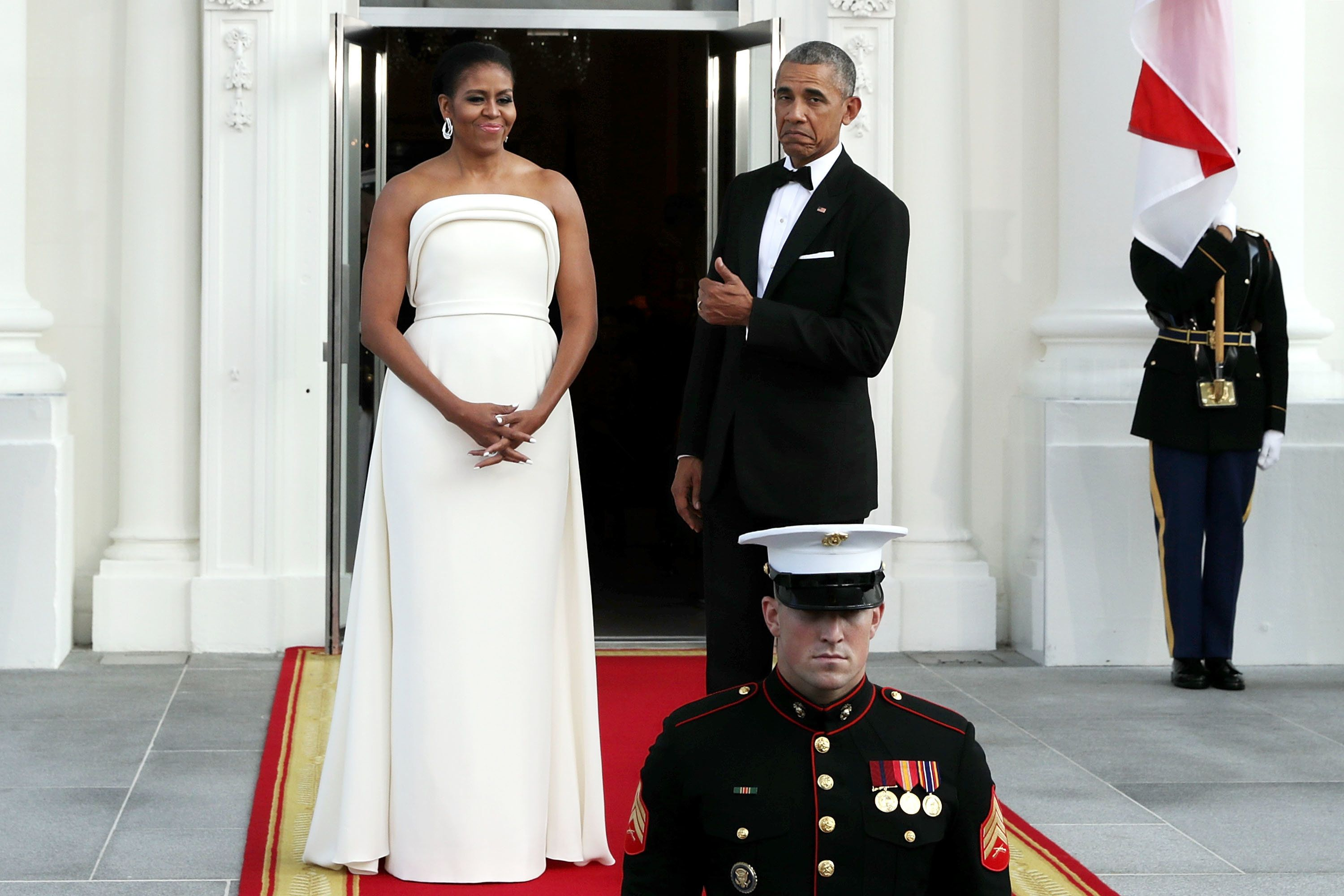 WASHINGTON, DC - AUGUST 02:  U.S. first lady Michelle Obama and U.S. President Barack Obama wait for the arrival of  Prime Minister Lee Hsien Loong of Singapore and his wife Ho Ching on the North Portico of the White House August 2, 2016 in Washington, DC. The Obamas are hosting the prime minister and his wife for an official state dinner.  (Photo by Chip Somodevilla/Getty Images)