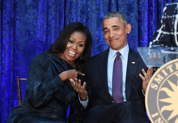 Former first lady Michelle Obama and former President Barack Obama react after their portraits were unveiled at the Smithsonian National Portrait Gallery on Feb. 12, 2018.