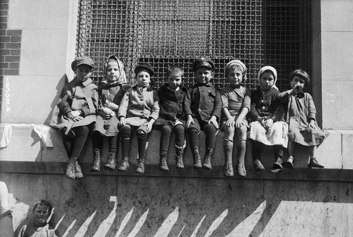 Children sit on a window ledge at an overcrowded immigration station at Ellis Island a century ago. When famil