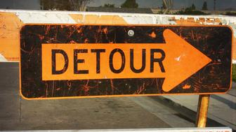 aged and worn detour sign