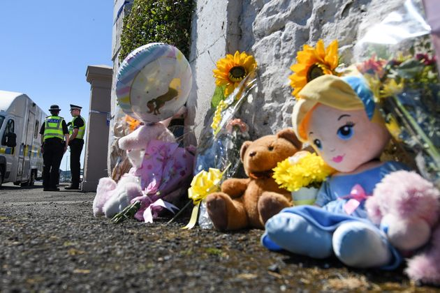 Tributes are left for six year old Alesha MacPhail at a house on Ardbeg Road.