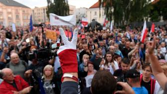 Protestors shout slogans and wave banners as they attend a demonstration in support of Supreme Court judges in front of The Supreme Court in Warsaw on July 3, 2018. - Poland's Chief Justice Malgorzata Gersdorf has refused to step down, defying a controversial new law by the right-wing government which requires her and other senior judges to retire early. (Photo by Janek SKARZYNSKI / AFP)        (Photo credit should read JANEK SKARZYNSKI/AFP/Getty Images)