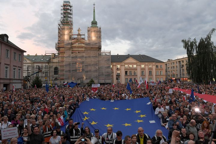 Protesters gather outside the Supreme Court building in Warsaw on Tuesday night.