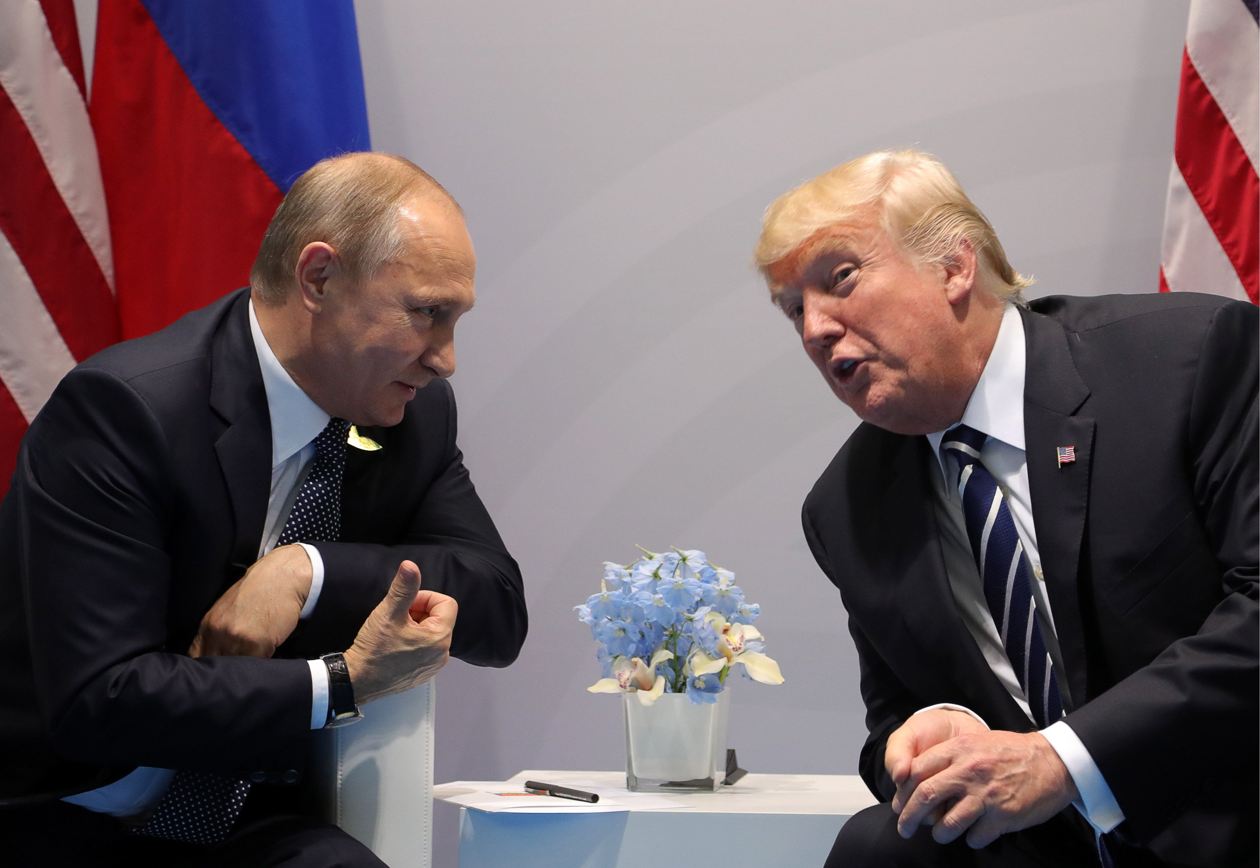 HAMBURG, GERMANY  JULY 7, 2017: Russia's President Vladimir Putin (L) and US President Donald Trump talking during a bilateral meeting on the sidelines of the G20 summit in Hamburg. Mikhail Klimentyev/Russian Presidential Press and Information Office/TASS (Photo by Mikhail Klimentyev\TASS via Getty Images)