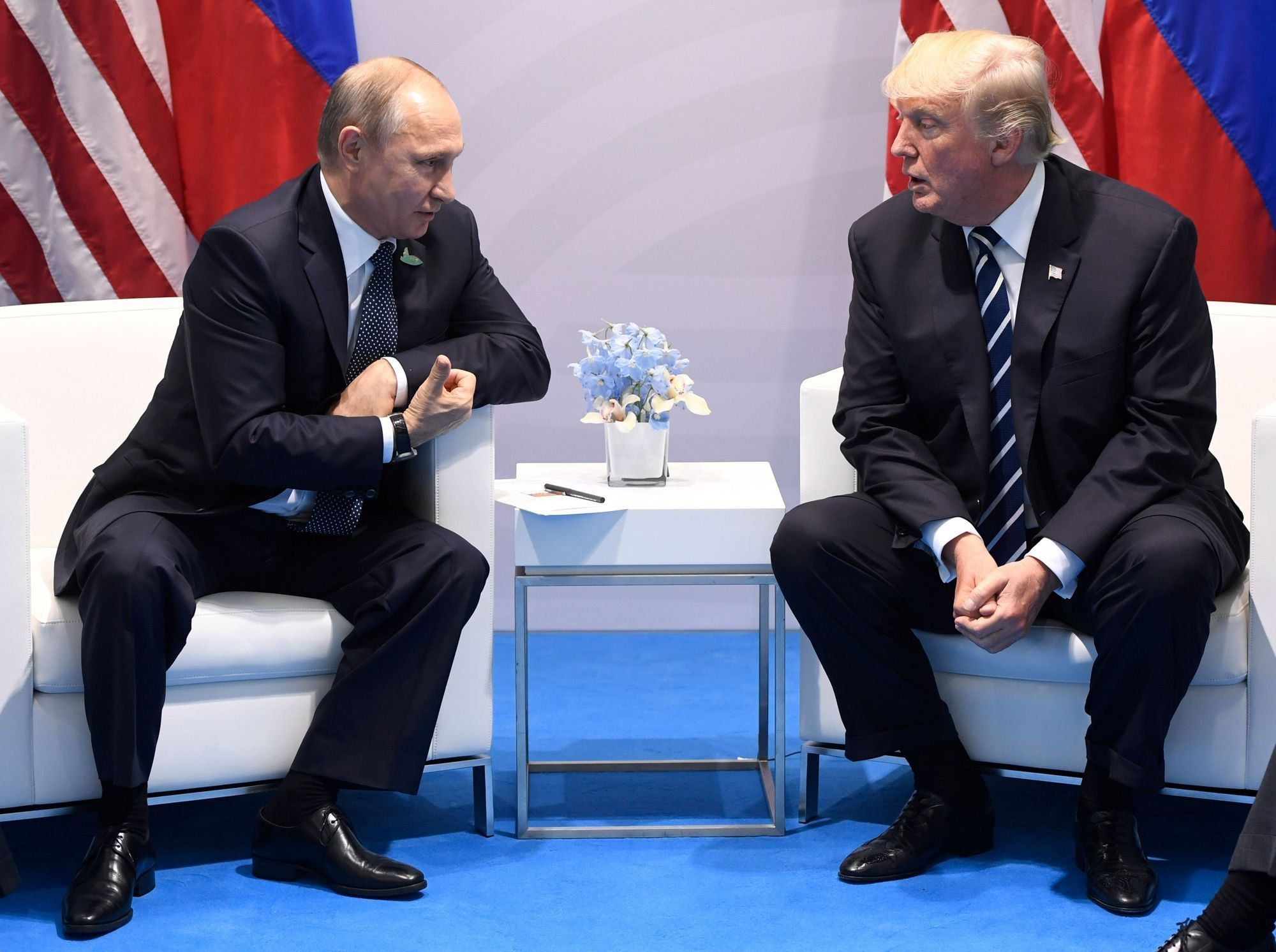 US President Donald Trump and Russia's President Vladimir Putin hold a meeting on the sidelines of the G20 Summit in Hamburg, Germany, on July 7, 2017. / AFP PHOTO / SAUL LOEB