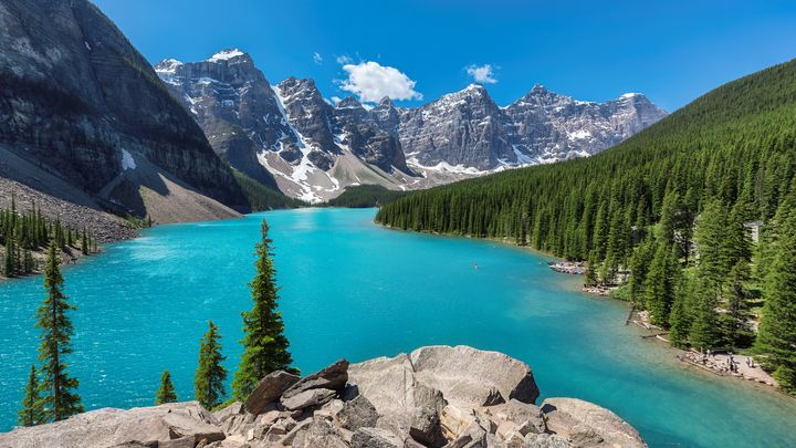 Banff National Park of Canada includes snow-covered peaks and Moraine Lake.