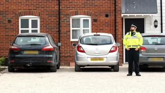 EDITORS NOTE: NUMBER PLATES PIXELLATED BY PA PICTURE DESK A police officer stands outside a block of flats on Muggleton Road in Amesbury, Wiltshire, where a major incident has been declared after it was suspected that two people might have been exposed to an unknown substance.