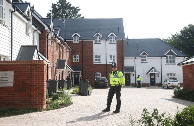 Police stand guard outside a block of flats on Muggleton Road in Amesbury where the couple were found...