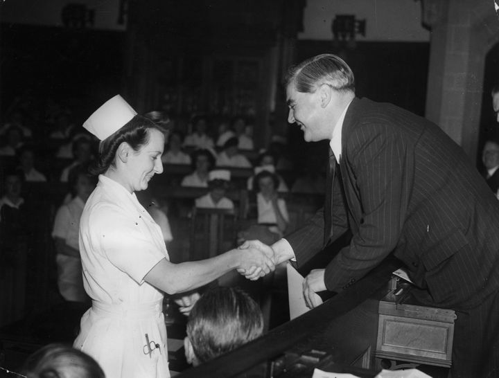British Health Minister Aneurin Bevan presents a certificate to Nurse Johnson, one of the successful nurses of the County Nur