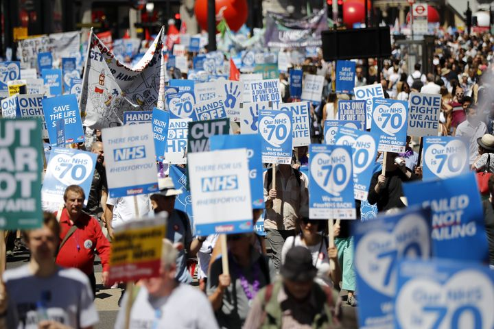 A march to celebrate the NHS and mark its 70th anniversary in central London on June 30, 2018.
