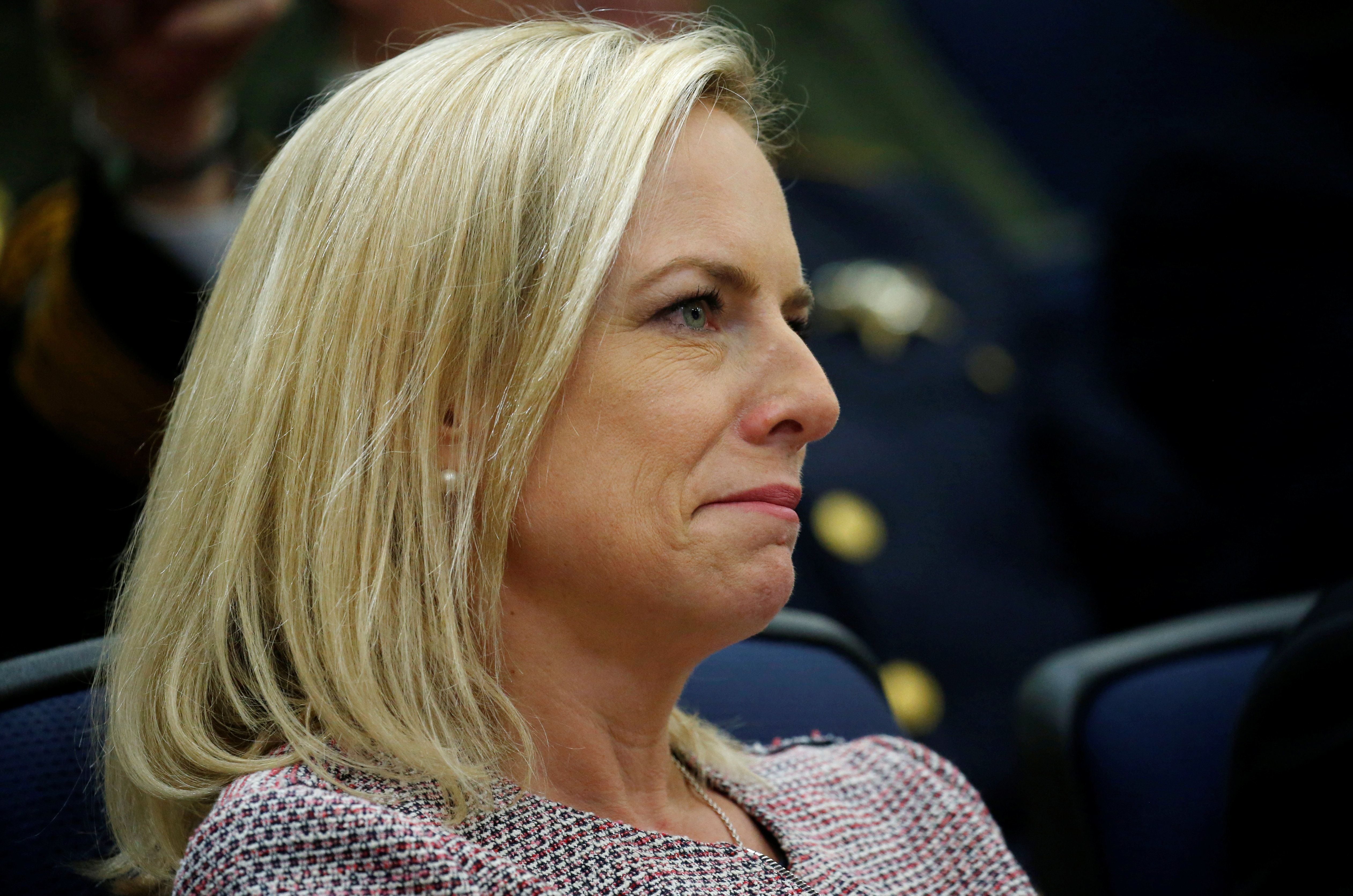 """DHS Secretary Kirstjen Nielsen listens to U.S. President Donald Trump speaking at an """"Angel Families"""" immigration event at the White House in Washington, U.S., June 22, 2018. REUTERS/Leah Millis"""
