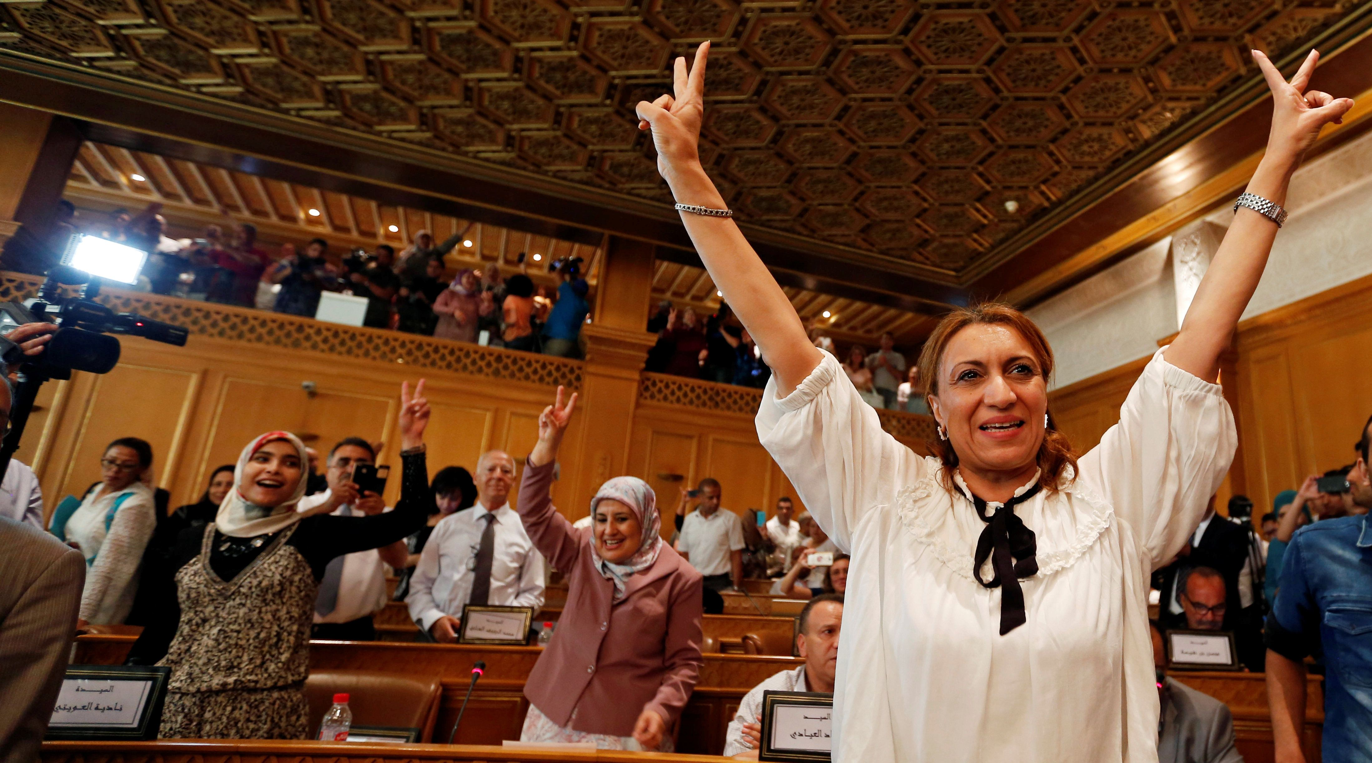 Souad Abderrahim, a candidate of the Islamist Ennahda party celebrates after being elected mayor of the city of Tunis, in Tunis, Tunisia July 3, 2018. She is the first Tunisian woman to hold the post. REUTERS/Zoubeir Souissi