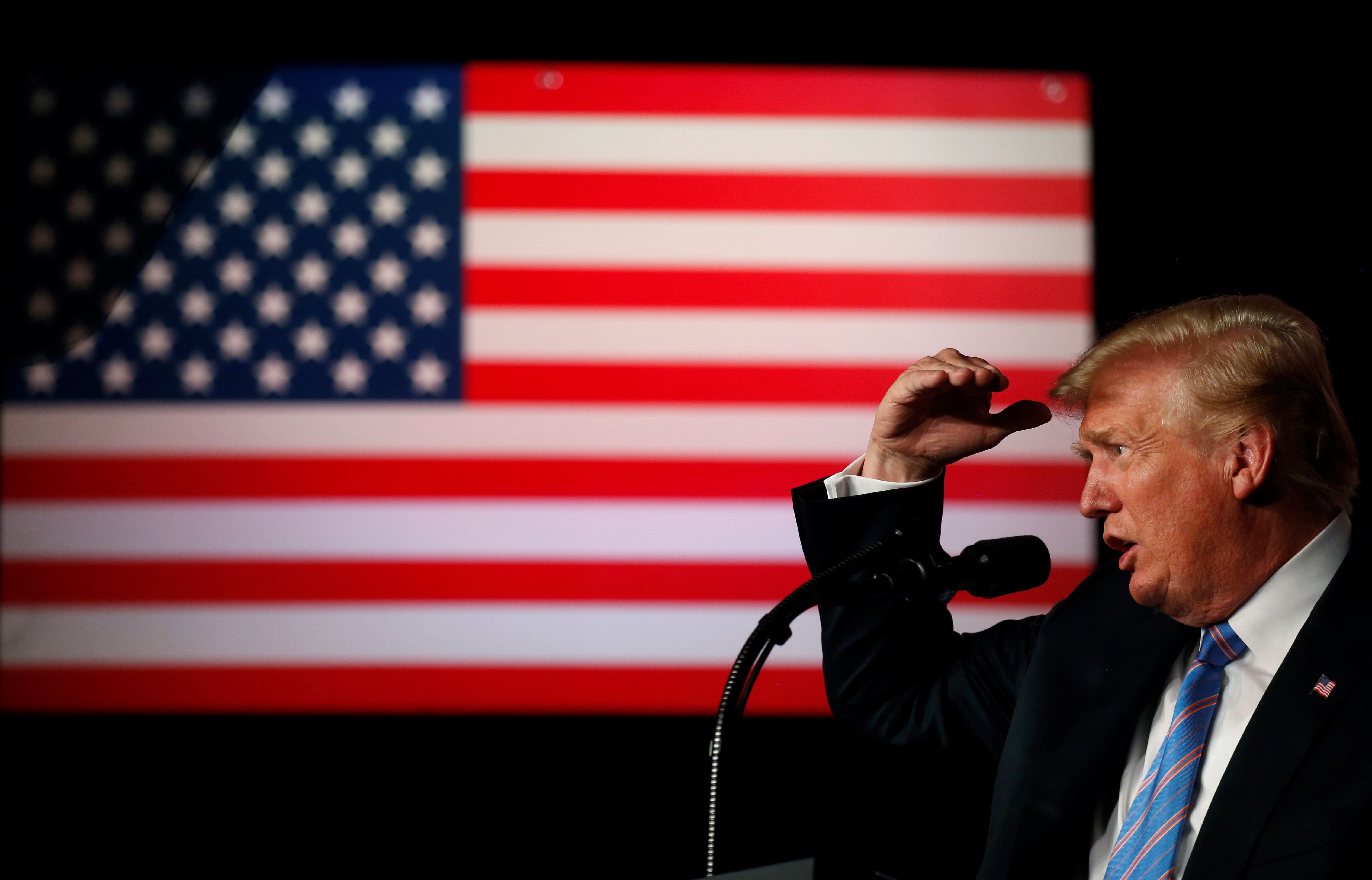 """U.S. President Donald Trump delivers remarks at a """"Salute to Service"""" dinner held in honor of the nation's military at The Greenbrier in White Sulphur Springs, West Virginia, U.S., July 3, 2018. REUTERS/Leah Millis"""