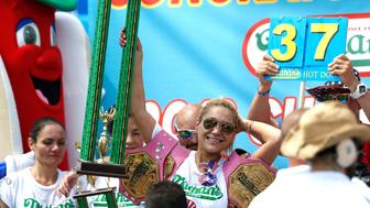 NEW YORK, USA - JULY 04: Miki Sudo celebrates her victory in the 2018 Nathan's Famous International Hot Dog Eating Contest at Coney Island in the Brooklyn borough of New York City, United States on July 4, 2018. (Photo by Atilgan Ozdil/Anadolu Agency/Getty Images)