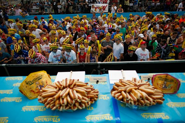 People attend the Annual Nathan's Hot Dog Eating Contest on July 4.