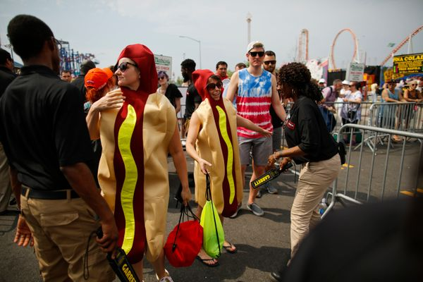Women dressed as hot dogs are checked as they arrive at the annual Nathan's Hot Dog Eating Contest.
