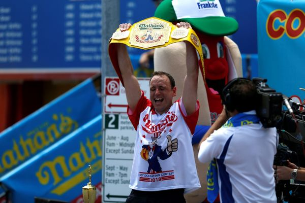 Joey Chestnut celebrates his victory.