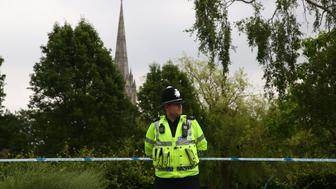 A police officer stands at a cordon outside Queen Elizabeth Gardens in Salisbury, southern England, on July 4, 2018 believed to be cordoned off in relation to a major incident declared after two people were found unconcious at a residence in nearby Amesbury. - Two people have been hospitalised in a critical condition for exposure to an 'unknown substance' in the same British city where former Russian spy Sergei Skripal and his daughter were poisoned with a nerve agent earlier this year. British police declared a 'major incident' after the couple, a man and a woman in their 40s, were discovered unconscious at a house in a quiet, newly-built area in Amesbury. (Photo by Geoff CADDICK / AFP)        (Photo credit should read GEOFF CADDICK/AFP/Getty Images)