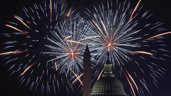 WASHINGTON, DC - JULY 04:  Fireworks explode overhead at the U.S. Capitol and the Washington Monument on Independence Day July 4, 2018 in Washington, DC. Americans celebrated the nation's 242nd year of independence today.  (Photo by Alex Wong/Getty Images)