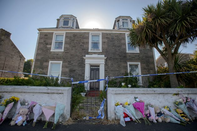 Police searching a house in Ardbeg Road on the Isle of Bute in