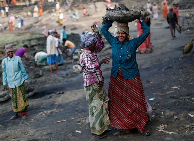 Women work at a dry pond on the outskirts of Kolkata, India, under theNational Rural Employment...