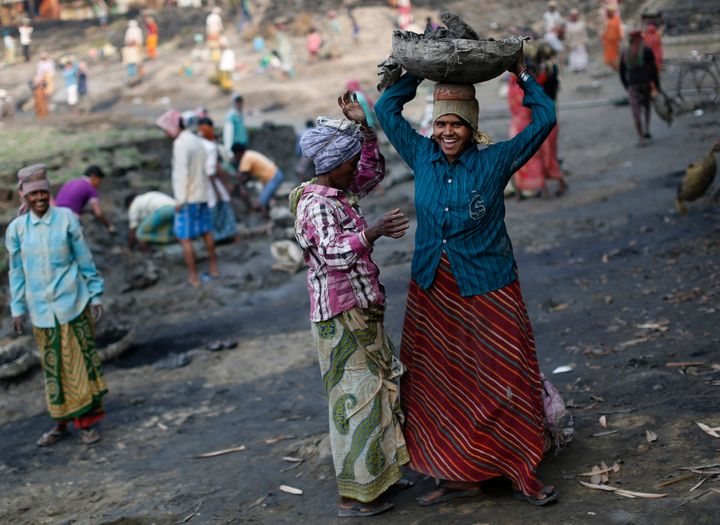 Women work at a dry pond on the outskirts of Kolkata, India, under the National Rural Employment Guarantee, an anti-pove