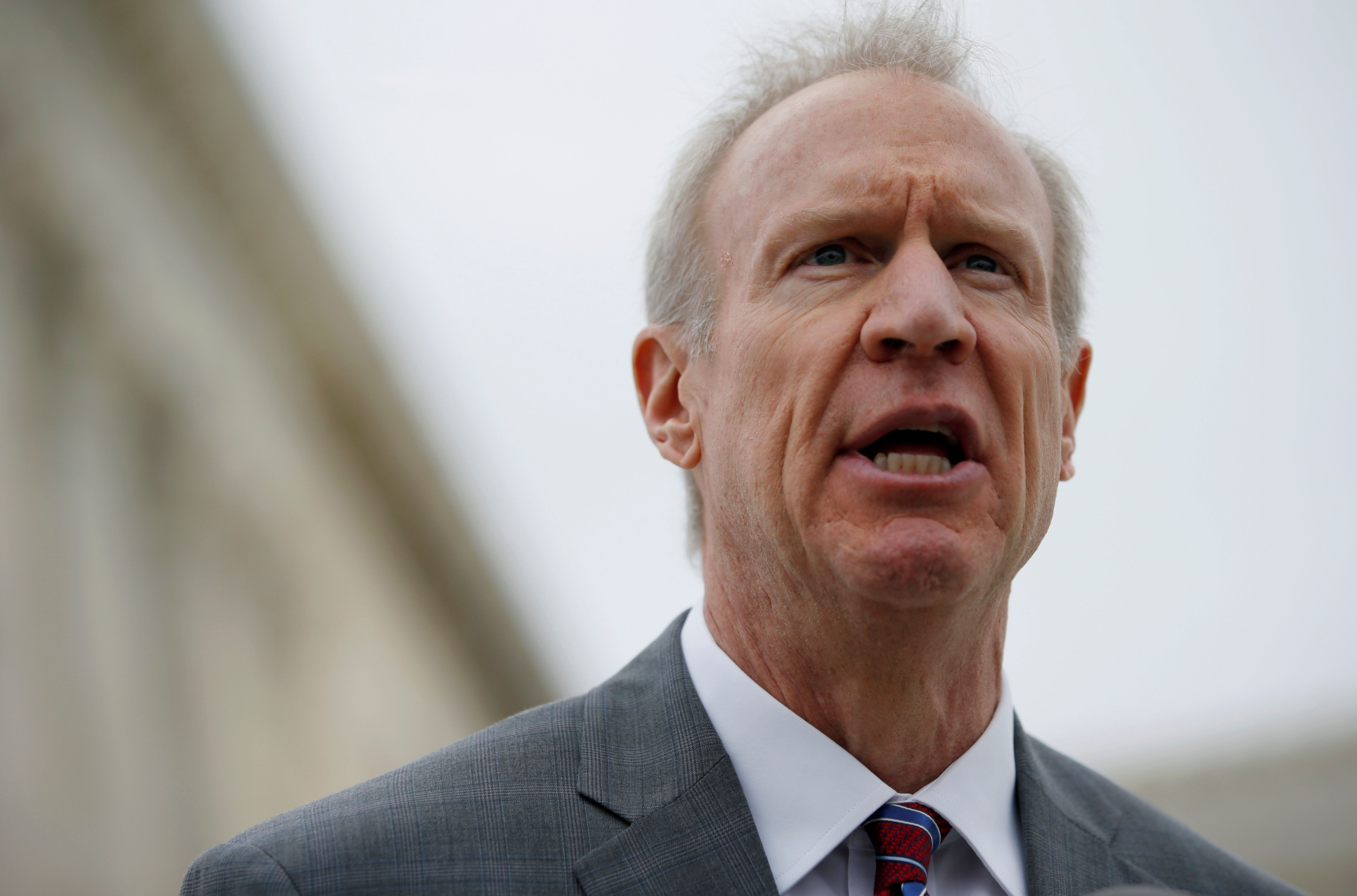 Illinois Gov. Bruce Rauner speaks to the news media outside of the United States Supreme Court in Washington, U.S., February 26, 2018. REUTERS/Leah Millis