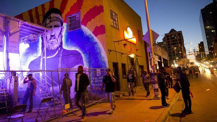 Pedestrians walk past a Willie Nelson mural during the South by Southwest festival in Austin, Texas. The number of drunken pe