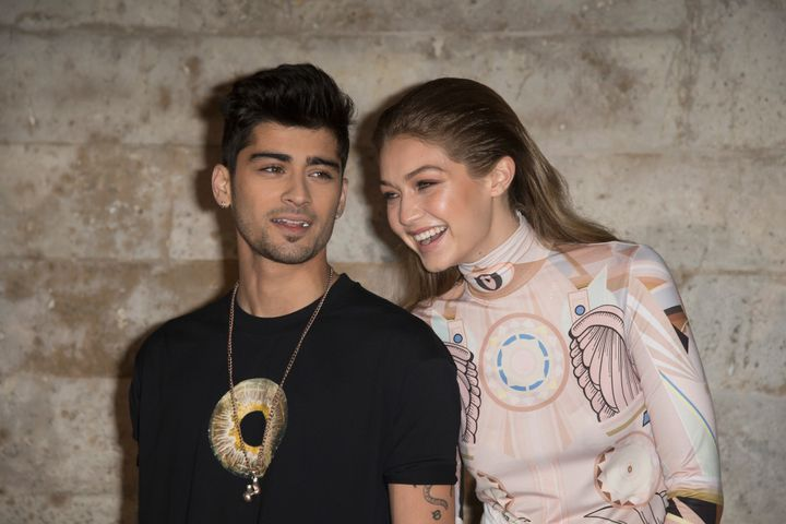 Zayn Malik and Gigi Hadid attend the Givenchy show on Oct. 2, 2016, in Paris.