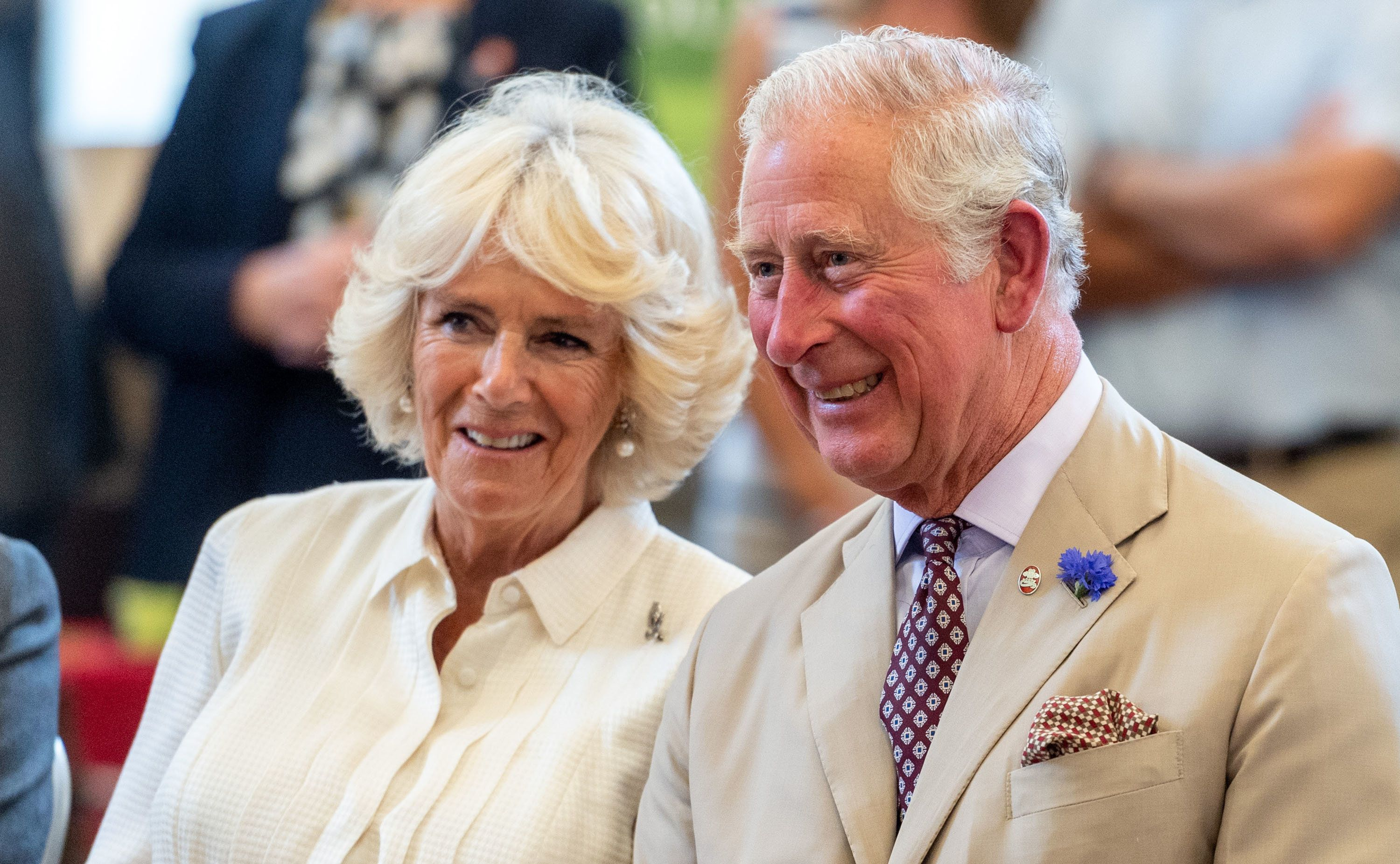 BUILTH WELLS, WALES - JULY 04: Prince Charles, Prince of Wales and Camilla, Duchess of Cornwall watch a performance at The Strand Hall on July 4, 2018 in Builth Wells, Wales. (Photo by Mark Cuthbert/UK Press via Getty Images)
