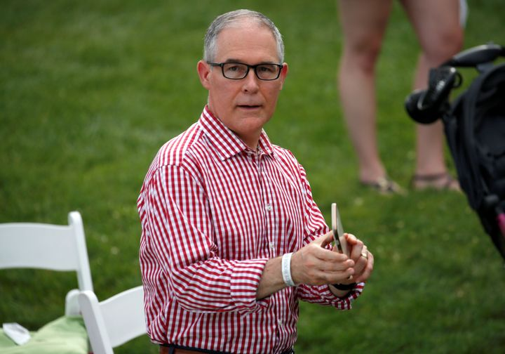 Environmental Protection Agency Administrator Scott Pruitt holds a mobile phone during a picnic for military families celebra