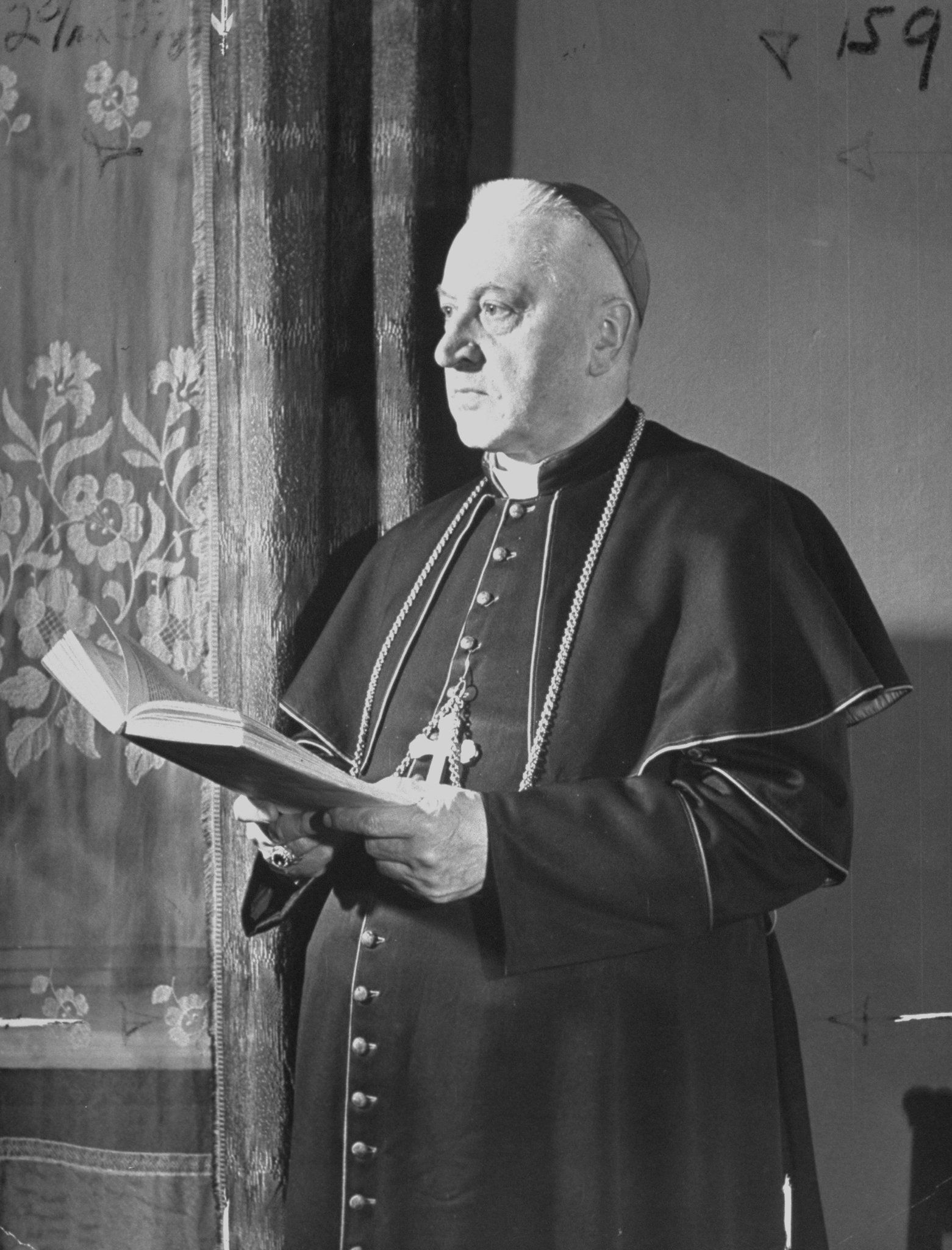 Polish Cardinal August Hlond standing and holding book.  (Photo by Tony Linck/The LIFE Picture Collection/Getty Images)