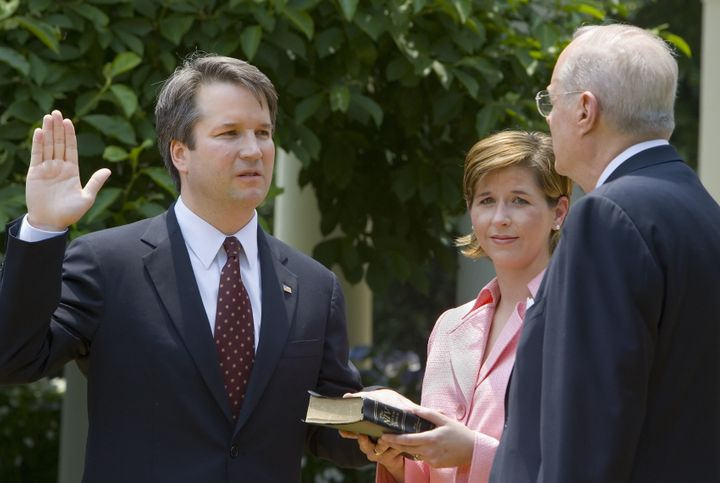 Brett Kavanaugh (L) is sworn in as a judge for the U.S. Court of Appeals for the District of Columbia Circuit by Supreme Cour
