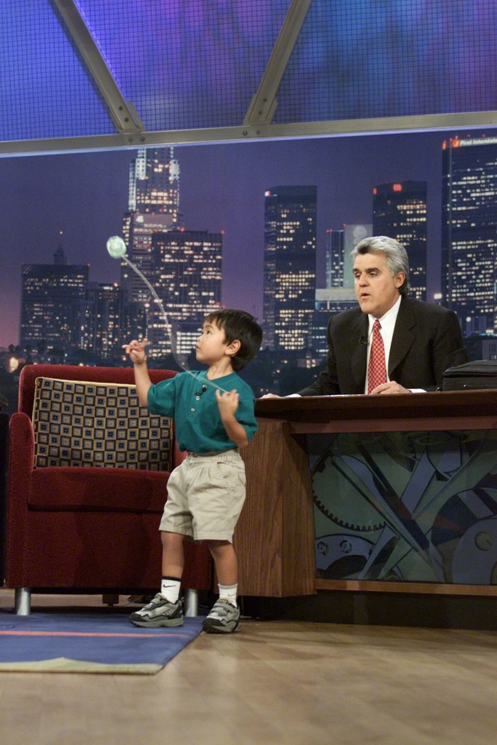 Talented Evan Nagao shows off his skills with host Jay Leno on March 22, 2001