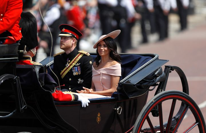 Markle in an off-the-shoulder Carolina Herrera dress at the Trooping the Colour. It's still a similar style to the boat neck neckline she favors.