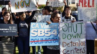 SANTA ANA, CALIFORNIA - MARCH 27: A small group of sanctuary state supporters gather outside the Orange County Board of Supervisors meeting as they prepare to discuss joining a DOJ lawsuit against the state of California in Santa Ana on Tuesday, Mar 27, 2018. (Photo by Jeff Gritchen/Orange County Register via Getty Images)'n