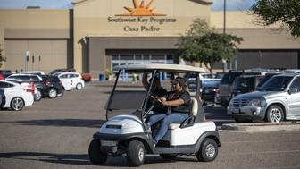 Security guards monitor the perimeter of the Southwest Key-Casa Padre Facility, formerly a Walmart Inc. store, in Brownsville, Texas, U.S., on Sunday, June 17, 2018. Democrats escalated their attacks on President Donald Trump's policy of separating immigrant children from parents who illegally cross the Mexican border, as public outrage over the practice balloons into an election-year headache for Republicans. Photographer: Sergio Flores/Bloomberg via Getty Images