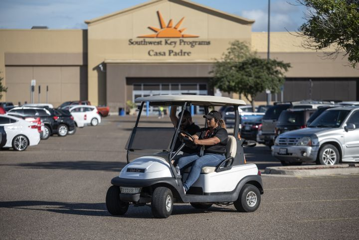 Security guards monitor the perimeter of the Southwest Key-Casa Padre Facility, formerly a Walmart store, in Brownsville, Tex
