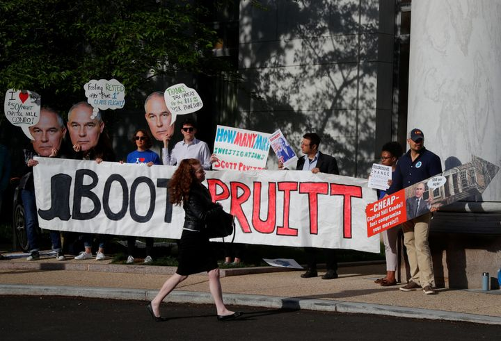 People protest before EPA Administrator Scott Pruitt testifies before a House Energy and Commerce Subcommittee hearing in Apr