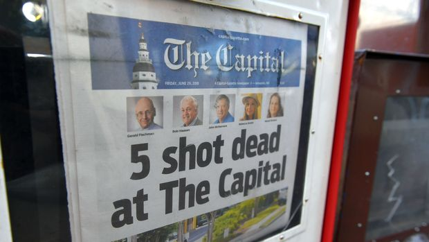 The Capital Gazette of June 29, 2018, is seen in a newspaper vending box in Annapolis, Maryland. - A man armed with a shotgun and smoke grenades burst into the newspaper office on June 28, killing five employees in what police described as a 'targeted attack.' The Baltimore Sun, which owns the Capital Gazette, identified the suspected shooter as Jarrod Ramos, who it said had a long-running dispute with the newspaper. (Photo by Mandel NGAN / AFP)        (Photo credit should read MANDEL NGAN/AFP/Getty Images)